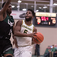 3rd year forward Shaquille Harris (6) of the Regina Cougars in action during the home opener on November  10 at Centre for Kinesiology, Health and Sport. Credit: Arthur Ward/Arthur Images