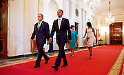 31.MAY.2012. WASHINGTON D.C<br /> <br /> PRESIDENT BARACK OBAMA AND FIRST LADY MICHELLE OBAMA WALK WITH FORMER PRESIDENT GEORGE W. BUSH AND FORMER FIRST LADY LAURA BUSH IN THE CROSS HALL TOWARDS THE EAST ROOM OF THE WHITE HOUSE, MAY 31, 2012. THE PRESIDENT AND FIRST LADY HOSTED A CEREMONY TO UNVEIL THE BUSHES' OFFICIAL PORTRAITS, WHICH WILL BE DISPLAYED IN THE WHITE HOUSE. <br /> <br /> BYLINE: EDBIMAGEARCHIVE.CO.UK<br /> <br /> *THIS IMAGE IS STRICTLY FOR UK NEWSPAPERS AND MAGAZINES ONLY*<br /> *FOR WORLD WIDE SALES AND WEB USE PLEASE CONTACT EDBIMAGEARCHIVE - 0208 954 5968*