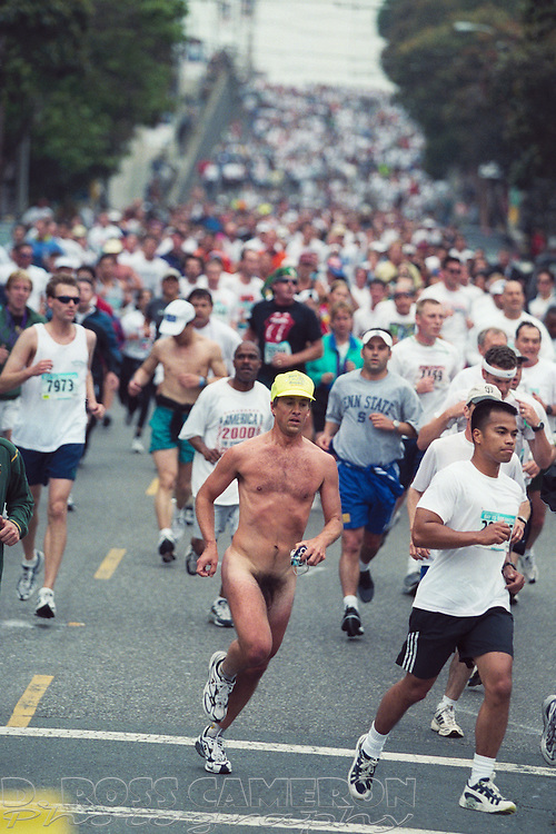 Amongst the tens of thousands of participants, a naked man, part of the Bare to Breakers naturist contingent, turns from Hayes Street onto Divisidero at the 91st running of the Bay to Breakers 12K race, Sunday, May 19, 2002 in San Francisco. (Photo by D. Ross Cameron)