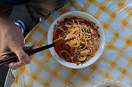 Pensioner's breakfast. Curry mee (curried rice noodles with coconut milk), Penang, Malaysia