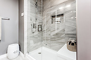 Bathroom shower with crystal doors from upscale house to be sold in Real Estate Market.