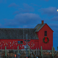 This New England photography image of Rockport Motif #1 with a rising full moon is available as museum quality photography prints, canvas prints, acrylic prints, wood prints or metal prints. Prints may be framed and matted to the individual liking and decorating needs: <br /> <br /> https://juergen-roth.pixels.com/featured/wolf-moon-over-massachusetts-rockport-harbor-juergen-roth.html<br /> <br /> New England harbor scenery photography of this famous red fishing shack in Rockport, MA on Cape Ann was photographed on a bitter cold night in January. The historic landmark is known throughout New England as Motif #1, so called because it is the most often painted building in America.<br /> <br /> Good light and happy photo making!<br /> <br /> My best,<br /> <br /> Juergen<br /> Licensing: http://www.rothgalleries.com<br /> Photo Prints: http://fineartamerica.com/profiles/juergen-roth.html<br /> Photo Blog: http://whereintheworldisjuergen.blogspot.com<br /> Instagram: https://www.instagram.com/rothgalleries<br /> Twitter: https://twitter.com/naturefineart<br /> Facebook: https://www.facebook.com/naturefineart
