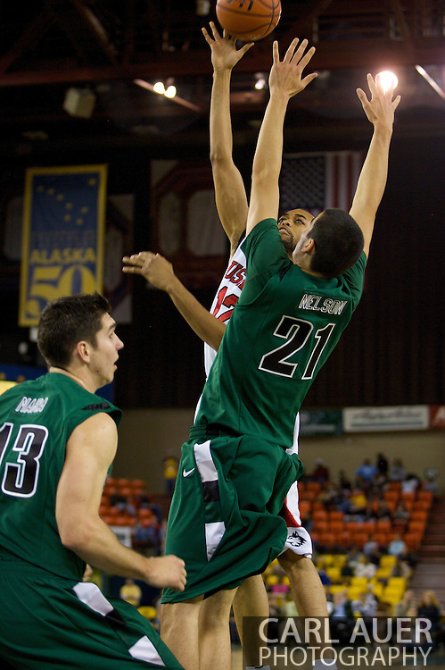 November 26, 2008: Northern Illinois forward Sean Smith (12) shoots over Portland State forward Phil Nelson (21) in game two of the 2008 Great Alaska Shootout at the Sullivan Arena.