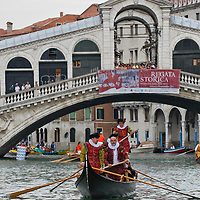 VENICE, ITALY - SEPTEMBER 04:  Rowers wearing traditional costumes take part in the Historic Regata on the Grand Canal at Rialto Bridge on September 4, 2011 in Venice, Italy. The Historic Regata is the most popular boat race on the Gran Canal for locals and tourists alike.