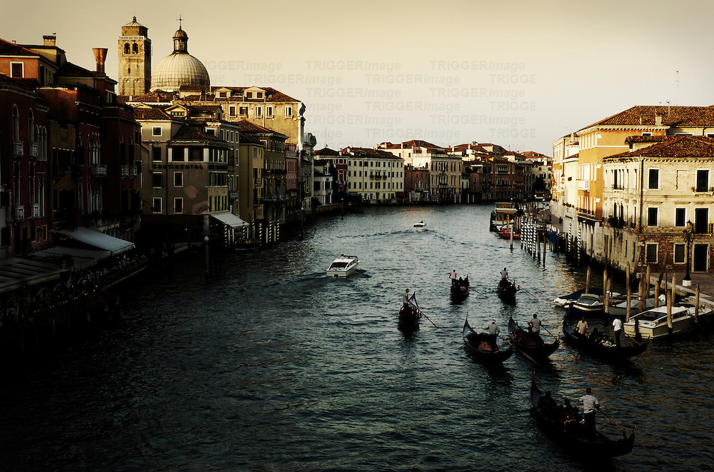 A view from The Rialto Bridge built in 1591 of The Grand Canal, Venice, Italy with gondolas