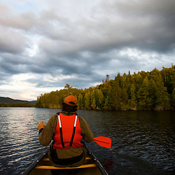 Canoeing on Prong Pond near Moosehead Lake in Maine USA (MR)