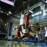 Delaware 87ers Forward Thanasis Antetokounmpo (19) drives to the basket as Fort Wayne Mad Ants Center Chris Hunter (32) defends during a NBA D-league regular season basketball game between the Delaware 87ers and The Fort Wayne Mad Ants Sunday, Dec. 15, 2013 at The Bob Carpenter Sports Convocation Center, Newark, DE
