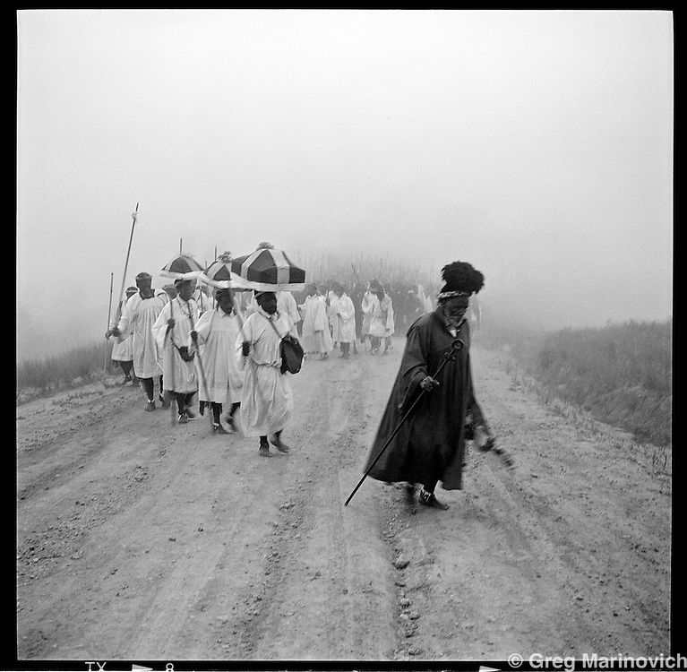 Church elders of the Nazareth baptist Church carrying the Communion artifacts they refer to as the Ark, lead over 100,000 members along a sand road on the first day their annual three day bare-foot pilgrimage from the church headquarters near KwaMashu to the holy mountain of Nhlangakazi, KwaZulu natal, January 1998. The pigrimage traces th footsteps and pays homage at shrines of the founder Isaiah Shembe's 1913 journey of enlightenment. Photo Greg Marinovich
