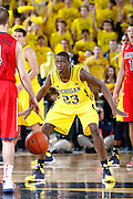 ANN ARBOR, MI - DECEMBER 14: Caris LeVert #23 of the Michigan Wolverines defends against the Arizona Wildcats during the game at Crisler Center on December 14, 2013 in Ann Arbor, Michigan. Arizona won the game 72-70. (Photo by Joe Robbins)
