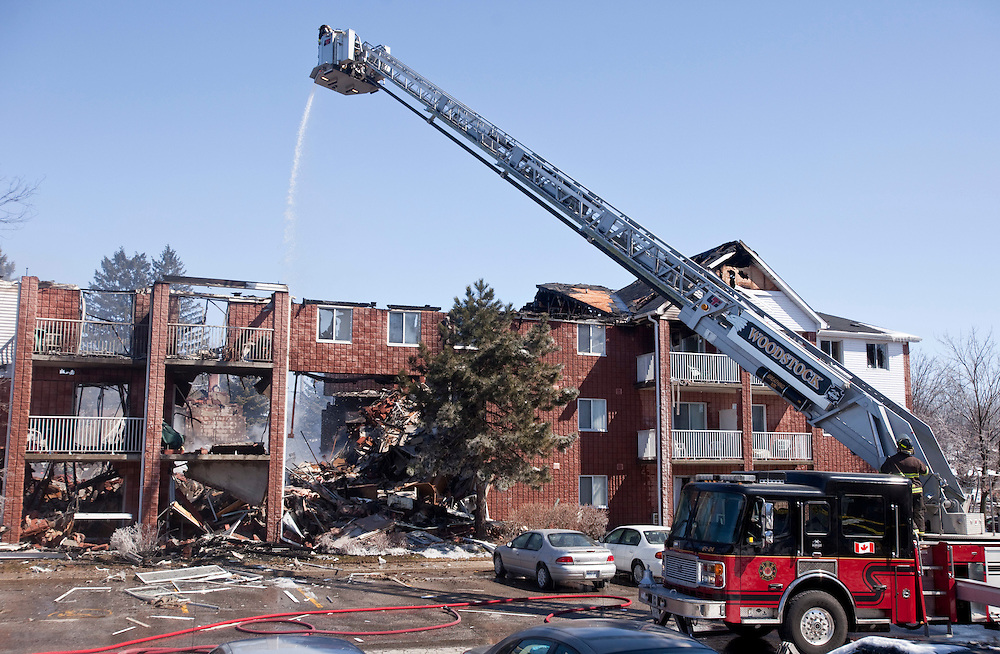 Woodstock, ONT.; March 27, 2011--  Firefighters pour water on the remains of a building in Woodstock, Ontario March 27, 2011 which exploded Sunday morning sending 7 people to hospital with several more unaccounted for.<br /> (GEOFF ROBINS/ Postmedia News)