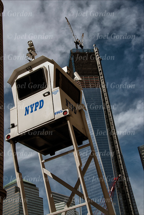 Optical illusion, images  are perceived by our eyes are deceptive and do not match with the actual size and shape of the object.<br /> <br /> Illusion of size relationship of NYPD Sky Watch in foreground with One World Trade Center in background.
