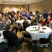 People clap for all of the nominees, standing, during the Daily Journal's Top 40 Under 40 lunch event Thursday afternoon at the First United Methodist Church in Tupelo.