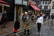 Visitors to central London make a selfie opposite Liberty's shop on Great Marlborough Street.