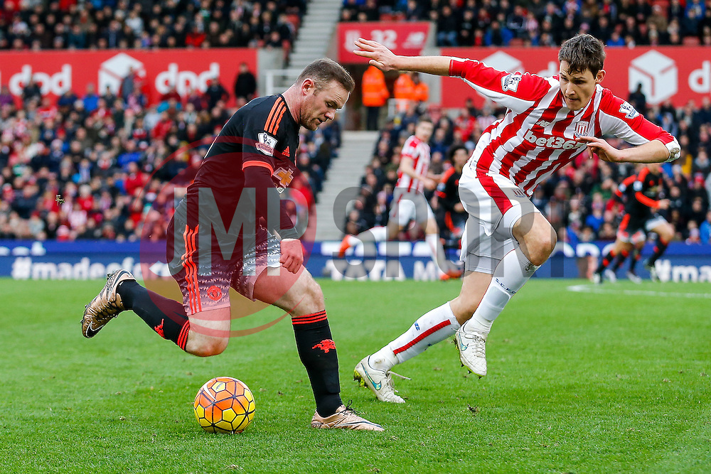 Wayne Rooney of Manchester United is challenged by Philipp Wollscheid of Stoke City - Mandatory byline: Rogan Thomson/JMP - 26/12/2015 - FOOTBALL - Britannia Stadium - Stoke, England - Stoke City v Manchester United - Barclays Premier League - Boxing Day Fixture.