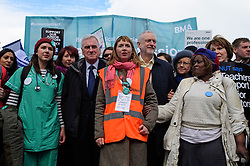 © Licensed to London News Pictures. 26/04/2016. London, UK.  Shadow chancellor JOHN MCDONNELL (centre left) and Labour leader JEREMY CORBYN (centre right) join Junior doctors and supporters as they stage a protest in Westminster, London as part of all-out strike action against planned changes to their contracts. The march starts at St Thomas Hospital and ends outside the Department of Health in Whitehall..  Photo credit: Ben Cawthra/LNP