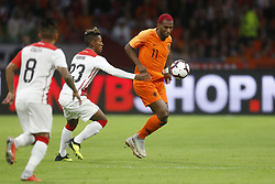 (L-R), Christian Cueva of Peru, Pedro Aquino of Peru, Ryan Babel of Holland during the International friendly match match between The Netherlands and Peru at the Johan Cruijff Arena on September 06, 2018 in Amsterdam, The Netherlands