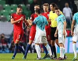 Gary Cahill of England argues with Bojan Jokic of Slovenia - Mandatory by-line: Robbie Stephenson/JMP - 11/10/2016 - FOOTBALL - RSC Stozice - Ljubljana, England - Slovenia v England - World Cup European Qualifier