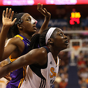 Sisters Chiney Ogwumike, (right), Connecticut Sun and Nneka Ogwumike, Los Angeles Sparks, (wearing face mask), playing against each other for the fist time in the WNBA during the Connecticut Sun Vs Los Angeles Sparks WNBA regular season game at Mohegan Sun Arena, Uncasville, Connecticut, USA. 3rd July 2014. Photo Tim Clayton