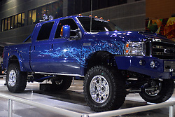 06 February 2005: A customized Ford 4x4 (four wheel drive) vehicle is displayed with oversized tires, a winch, custom suspension, a lift kit, and a flame illustration on the side.<br /> <br /> First staged in 1901, the Chicago Auto Show is the largest auto show in North America and has been held more times than any other auto exposition on the continent.  It has been  presented by the Chicago Automobile Trade Association (CATA) since 1935.  It is held at McCormick Place, Chicago Illinois