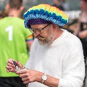 NLD/Amsterdam/20180604 - Gaypride 2018, man met rasta pet en panty's