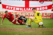 Walsall FC goalkeeper Liam Roberts (1) saves from Barnsley forward Cauley Woodrow during the EFL Sky Bet League 1 match between Walsall and Barnsley at the Banks's Stadium, Walsall, England on 23 March 2019.