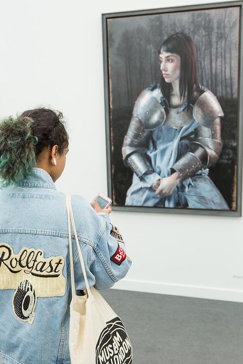 New York, NY - 6 May 2016. Frieze New York art fair. A woman in armor, reminiscent of Joan of Arc, by German artist Martin Eder, in Berlin's Galerie Eigen + Art.