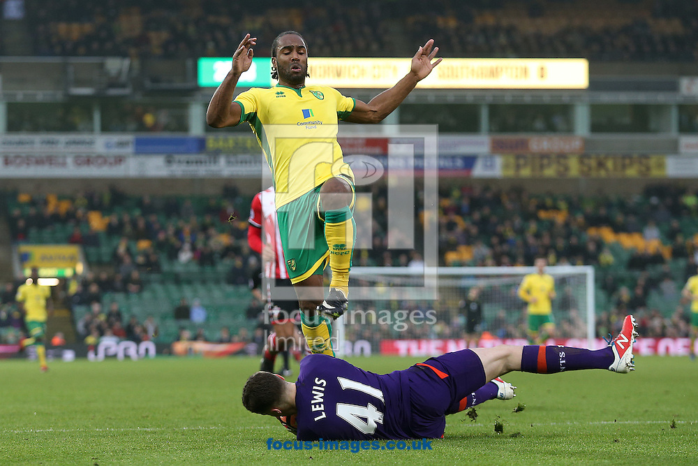 Harry Lewis of Southampton saves at the feet of Cameron Jerome of Norwich during the third round of the FA Cup at Carrow Road, Norwich<br /> Picture by Paul Chesterton/Focus Images Ltd +44 7904 640267<br /> 07/01/2017