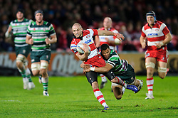 Gloucester Winger (#14) Charlie Sharples is tackled by London Irish Winger (#11) Anthony Watson during the second half of the match - Photo mandatory by-line: Rogan Thomson/JMP - Tel: Mobile: 07966 386802 15/12/2012 - SPORT - RUGBY - Kingsholm Stadium - Gloucester. Gloucester Rugby v London Irish - Amlin Challenge Cup Round 4.