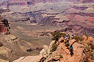 """Guided trail riders ascending the South Kaibab trail's """"windy ridge""""."""