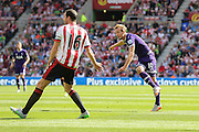 Tottenham Hotspur forward Harry Kane with a shot during the Barclays Premier League match between Sunderland and Tottenham Hotspur at the Stadium Of Light, Sunderland, England on 13 September 2015. Photo by Simon Davies.