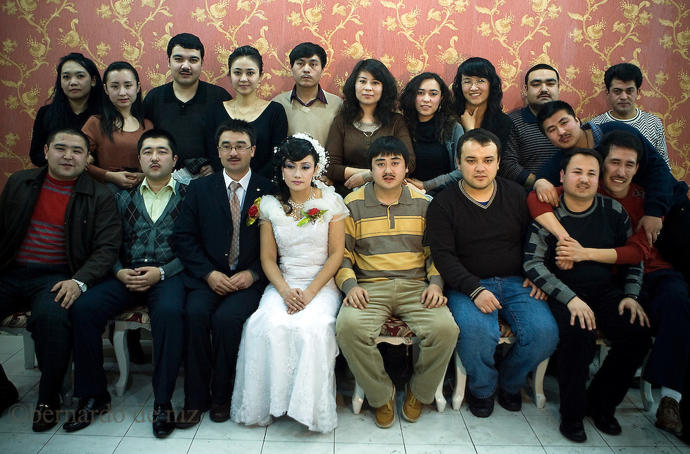 "Uyghurs posed for a portrait photo during a traditional wedding in .Kashgar, In Xinjiang Autonomus region in China, March, 2009. Photographer: Bernardo De Niz..The Uighurs are an ethnically Turkic Muslim people who have lived in what is now known as the Xinjiang Uighur Autonomous Region (XUAR) for over 4,000 years. Known as Eastern Turkestan for hundreds of years,.Xinjiang is located along the famous ""Silk Road"", beyond the Great Wall, the natural boundary of China. Islam.entered the region in the middle of the tenth century and has flourished among the Uighurs ever since."