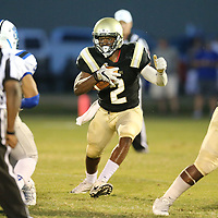 Amory running back Jartavis Jernighan finds a bid hole along the line early in the first quarter on Thursday.