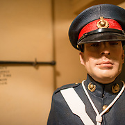 A life-size manequin of a guard at the Churchill War Rooms in London. The museum, one of five branches of the Imerial War Museums, preserves the World War II underground command bunker used by British Prime Minister Winston Churchill. Its cramped quarters were constructed from a converting a storage basement in the Treasury Building in Whitehall, London. Being underground, and under an unusually sturdy building, the Cabinet War Rooms were afforded some protection from the bombs falling above during the Blitz.