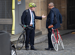 FILE PICTURE © Licensed to London News Pictures. 29/04/2019. London, UK. Boris Johnson (L) stands with his bicycle as he talks with Conservative Party Deputy Chairman James Cleverly in Parliament. Photo credit: Peter Macdiarmid/LNP