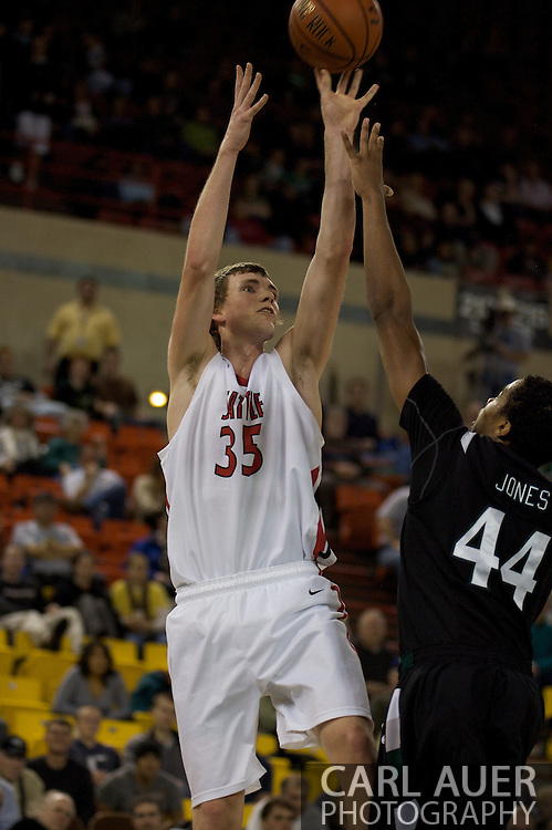 November 29th, 2008:  Anchorage, Alaska - Seattle University's Leigh Swanson (35) shoots over Portland State's Jamie Jones (44) in the third place game on the final day of the Great Alaska Shootout.