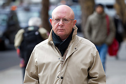 © Licensed to London News Pictures. 12/01/2012. London, UK. Peter Hill, former editor of the Daily Express, part of Northern and Shell, arrives at The Royal Courts of Justice to give evidence to the Leveson Inquiry in to the culture, practice and ethics of the press. Photo credit : LNP