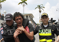 59594102  .Policemen arrest a man during a demonstration to commemorate the International Labour Day in San Jose, capital of Costa Rica, May 1, 2013,  May 2, 2013 Photo by: i-Images.UK ONLY