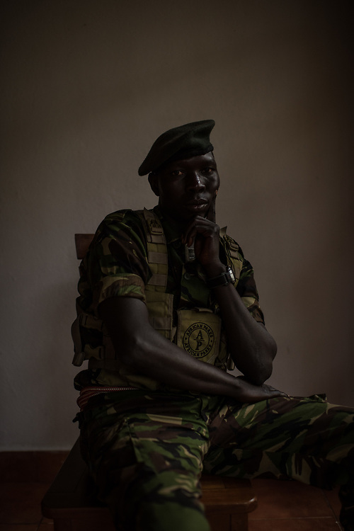 "John Agele Adriko, 33, from Aru Province, sits for a portrait at Garamba National Park on November 25, 2017. Adriko has been a ranger for 11 years in Garamba National Park, a park embattled with numerous threats to its wildlife which saw 21 attacks within a year, leading to five ranger deaths.<br /> <br /> ""There are some people when they see a snake they're are scared ant their reaction is to flee. There are other people who when they see a snake they are not scared and move closer to see what kind of snake it is."""