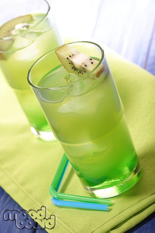 Glass of kiwi juice with ice