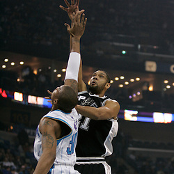 Mar 01, 2010; New Orleans, LA, USA; San Antonio Spurs center Tim Duncan (21) shoots over New Orleans Hornets forward David West (30) during the first half at the New Orleans Arena. Mandatory Credit: Derick E. Hingle-US PRESSWIRE