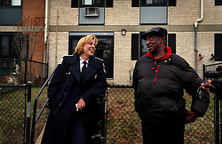 Police Chief Cathy L. Lanier chats with resident Napoleon Edwards, 68, while on patrol in Washington, D.C. on March 16, 2009. Edwards approached Lanier to congratulate her on doing such great work. Lanier, chief of police with the Metropolitan Police Department of the District of Columbia, MPDC, rose to her position from humble beginnings: she was a high-school dropout after ninth grade and an unwed mother at the age of 15. Despite a rough start, she later earned advanced academic degrees from the Johns Hopkins University and the Naval Postgraduate School in Monterey, Calif., where she completed a Masters in Security Studies. Lanier also attended the John F. Kennedy School of Government at Harvard University and is a graduate of the FBI Academy and the University of the District of Columbia. She has been on the force for 18 years.