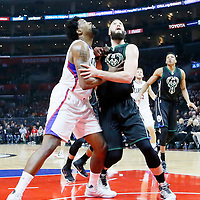 16 December 2015: Los Angeles Clippers center DeAndre Jordan (6) vies for the rebound with Milwaukee Bucks center Miles Plumlee (18) during the Los Angeles Clippers 103-90 victory over the Milwaukee Bucks, at the Staples Center, Los Angeles, California, USA.