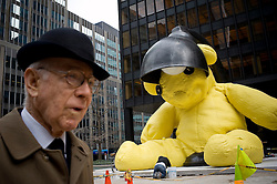 "New York, NY: Apr 06, 2011:.A 20-ton bronze teddy bear is set up in a Park Avenue plaza outside of the Seagram Building Thursday. The piece was created by New York-based artist Uri Fischer, and is to be auctioned by Christie's next month..The 23-foot-tall yellow bear is called ""Untitled (Lamp/Bear)"" and is expected to go for over $10 million. (caption with info from Gothamist).---.Photo by Rob Bennett for The Wall Street Journal.Slug: BigBear"