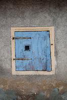 Close-up of a blue wooden window shutter in an old house in Kohren-Salis, German.