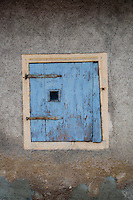Close-up of a blue wooden window shutter in an old house in Kohren-Salis, German.