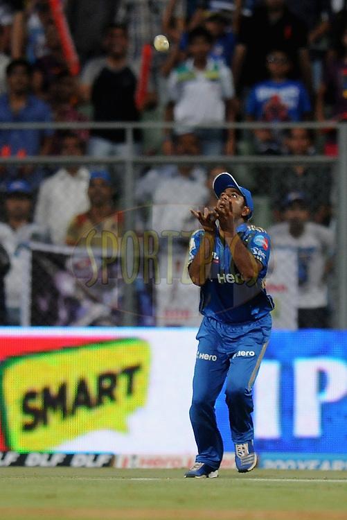 Ambati Raydu of Mumbai Indians takes a catch of David Hussey of Kings XI Punjab during match 28 of the Indian Premier League ( IPL) 2012  between The Mumbai Indians and the Kings X1 Punjab held at the Wankhede Stadium in Mumbai on the 22nd April 2012..Photo by Pal Pillai/IPL/SPORTZPICS.