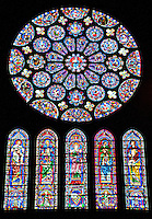 Our Lady of Chartres Cathedral, Chartres, France. Exquisite stained glass windows of the south Transept.The rose is dedicated to Christ, who is shown in the central oculus, surrounded by adoring angels. Two outer rings of twelve circles each contain the 24 Elders of the Apocalypse. The central lancet beneath the rose shows the Virgin carrying the infant Christ. Either side of this are four lancets showing the four evangelists sitting on the shoulders of four Prophets. The Counts of Dreux-Bretagne are depicted with their arms in the bases of the lancets.