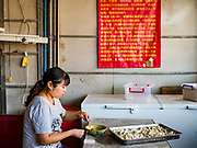 "14 FEBRUARY 2019 - SIHANOUKVILLE, CAMBODIA:  A Chinese woman makes small noodle dumplings in a Chinese noodle shop in Sihanoukville. There are thousands of Chinese workers in Sihanoukville who work to support the casino and hotel industry in the town. There are about 80 Chinese casinos and resort hotels open in Sihanoukville and dozens more under construction. The casinos are changing the city, once a sleepy port on Southeast Asia's ""backpacker trail"" into a booming city. The change is coming with a cost though. Many Cambodian residents of Sihanoukville  have lost their homes to make way for the casinos and the jobs are going to Chinese workers, brought in to build casinos and work in the casinos.      PHOTO BY JACK KURTZ"