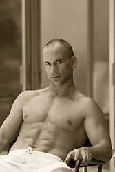 hunky man at home without a shirt