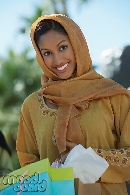 Portrait of muslim woman with shopping bag
